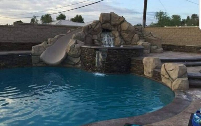 Water fountain and slide on a pool design