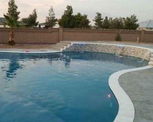 backyard with a new built natural form pool